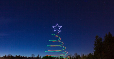Santa Claus and the Reindeer sleigh drone light painting